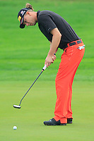Marcel Siem (GER) putts on the 1st green during Thursday's Round 1 of the 2014 BMW Masters held at Lake Malaren, Shanghai, China 30th October 2014.<br /> Picture: Eoin Clarke www.golffile.ie