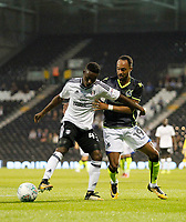Fulham's Steven Sessegnon is pressured by Bristol Rovers' Byron Moore during the Carabao Cup match between Fulham and Bristol Rovers at Craven Cottage, London, England on 22 August 2017. Photo by Carlton Myrie.