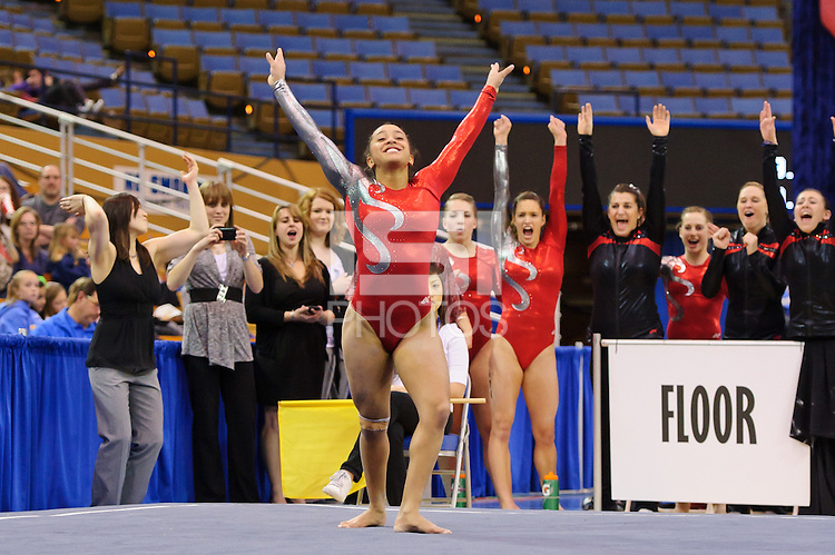 LOS ANGELES, CA - March 19, 2011:  Stanford's Ashley Morgan competes in floor exercise during the Pac-10 Championship at UCLA's Pauley Pavilon.  Morgan tied for first in floor exercise with a score of 9.90.  Stanford placed fourth in the team competition.