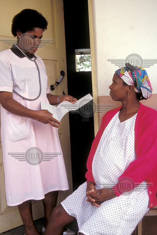 © Giacomo Pirozzi / Panos Pictures..CAPE VERDE..Nurse talking to pregnant woman at health clinic.