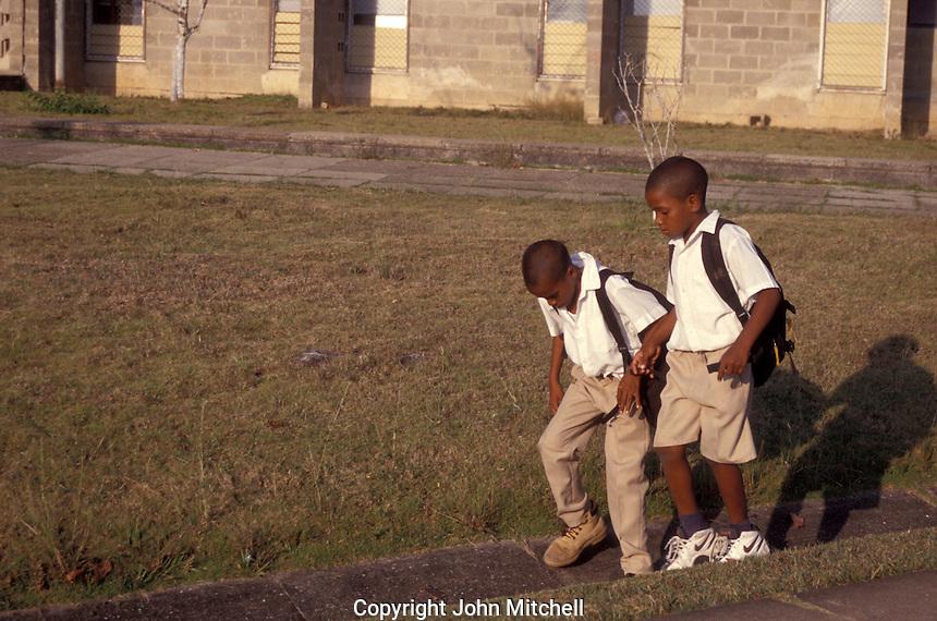 Two Belizian boys on their way to school in Belmopan, Belize