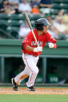 Third baseman Carlos Asuaje (20) of the Greenville Drive bats in a game against the Lexington Legends on Sunday, April 27, 2014, at Fluor Field at the West End in Greenville, South Carolina. Greenville won, 21-6. (Tom Priddy/Four Seam Images)