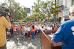 National Alliance for Mental Health Walk in Los Angeles, Santa Monica, CA. with crowd listening to speaker on stand before walk begins