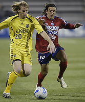 08 November 2006: CSD Municipal's Mario Rodriguez, right, and Columbus Crew's Tim Ward chase a loose ball during the first half in Columbus, Ohio.<br />