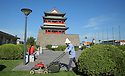 Gardener mowing lawn. Front Gate Tiananmen Square. Beijing China