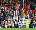Chris Wilder manager of Sheffield Utd with Stefan Scougall of Sheffield Utd during the English League One match at Glanford Park Stadium, Scunthorpe. Picture date: September 24th, 2016. Pic Simon Bellis/Sportimage