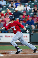 Oklahoma City RedHawks third baseman Brandon Laird (4) follows through on his swing during the Pacific Coast League baseball game against the Round Rock Express on July 9, 2013 at the Dell Diamond in Round Rock, Texas. Round Rock defeated Oklahoma City 11-8. (Andrew Woolley/Four Seam Images)