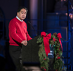 A. Gabriel Esteban, Ph.D., president of DePaul University, greets the guests gathered for the Friday, Dec. 8, 2017, performance of Christmas at DePaul at the Saint Vincent de Paul Parish Church in Lincoln Park. Christmas at DePaul is the retelling of the birth of Christ in word and song. The event is offered as a gift to the community and guests are asked to donate either money or food items to support the St. Vincent de Paul Parish Food Pantry. Each year a student is selected from The Theatre School to narrate the sacred story as selections of classical holiday music celebrating the birth of Christ are performed by the DePaul Community Chorus and student musicians from the School of Music. (DePaul University/Jamie Moncrief)