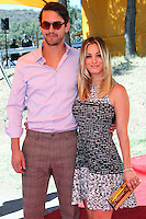 PACIFIC PALISADES, CA - OCTOBER 05: Actress Kaley Cuoco and Fiancé Ryan Sweeting arrive at the 4th Annual Veuve Clicquot Polo Classic held at Will Rogers Polo Grounds on October 5, 2013 in Pacific Palisades, California. (Photo by Xavier Collin/Celebrity Monitor)