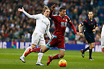 Real Madrid´s Luka Modric (L) and Real Sociedad´s Jonathas de Jesus during La Liga match between Real Madrid and Real Sociedad at Santiago Bernabeu stadium in Madrid, Spain. December 30, 2015. (ALTERPHOTOS/Victor Blanco)