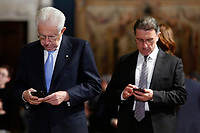 Two Senators watching their phones<br /> Rome December 19th 2018. Quirinale. Traditional exchange of Christmas wishes between the President of the Republic and the institutions.<br /> Foto Samantha Zucchi Insidefoto
