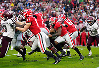 ATHENS, GA - NOVEMBER 23: D'Andre Swift #7 of the Georgia Bulldogs runs behind his line during a game between Texas A