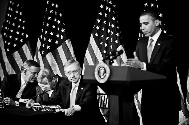 President Barack Obama answers questions from Senate Democrats during their retreat at the Newseum in Washington on Feb. 3, 2010. To the left are Sen. Byron Dorgan, D-N. Dak., Sen. Richard Durbin, D-Ill., and Senate Majority Leader Harry Reid, D-Nev.