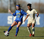 BROOKINGS, SD, OCTOBER 21: Abigail Kastens #21 from South Dakota State controls the ball in front of Chamelle Wiltshire #11 from Oral Roberts during their match Sunday afternoon at Fischback Soccer Field in Brookings. (Dave Eggen/Inertia)