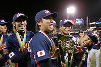 Tomoya Satozaki and Toshiaki Imae of Japan during World Baseball Championship at Petco Park in San Diego,California on March 20, 2006. Photo by Larry Goren/Four Seam Images