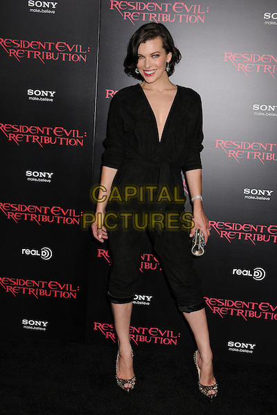 "Milla Jovovich.""Resident Evil: Retribution"" Los Angeles Premiere held at Regal Cinemas L.A. Live, Los Angeles, California, USA..September 12th, 2012.full length black jumpsuit cropped trousers gold peep toe shoes silver clutch bag.CAP/ADM/BP.©Byron Purvis/AdMedia/Capital Pictures."