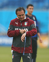 Italy coach Cesare Prandelli checks his watch during training ahead of tomorrow's Group D match vs Uruguay