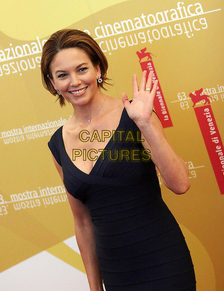 "DIANE LANE.Photocall for ""Hollywoodland"" on the second day of the 63rd Venice Film Festival, Venice, Italy..August 31st, 2006.Ref: OME.half length blue dress hand waving.www.capitalpictures.com.sales@capitalpictures.com.©Omega/Capital Pictures."