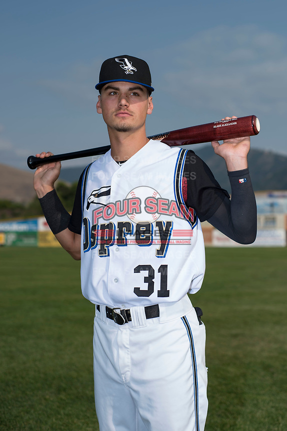 Missoula Osprey infielder Blaze Alexander (31) poses for a photo prior to a Pioneer League game against the Grand Junction Rockies at Ogren Park Allegiance Field on August 21, 2018 in Missoula, Montana. The Missoula Osprey defeated the Grand Junction Rockies by a score of 2-1. (Zachary Lucy/Four Seam Images)