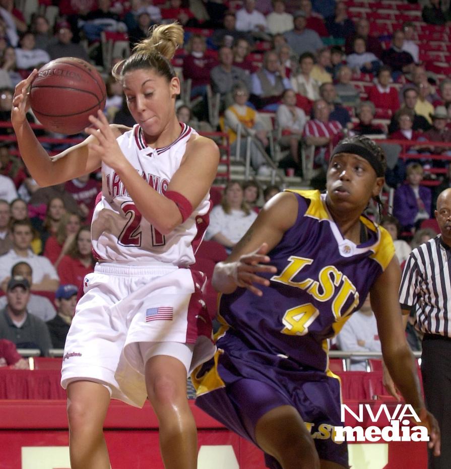 Arkansas Democrat-Gazette/LORI McELROY<br /><br />Arkansas Ladyback India Lewis pulls down an offensive rebound against LSU's Doneeka Hodges in the second half.<br />2-10-02
