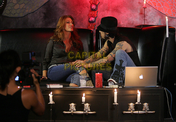 ANGIE EVERHART & DAVE NAVARRO.At Dave Navarro's Spread Entertainment weekly internet show,episode 3 on Maniatv.com held at The Dragonfly in Hollywood, California, USA..May 31st, 2007.full length brown shirt hand on leg knee black hat tattoos.CAP/DVS.©Debbie VanStory/Capital Pictures