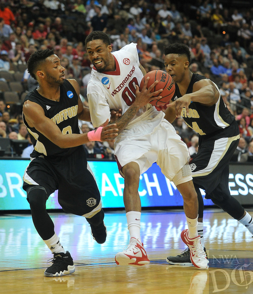 NWA Democrat-Gazette/Michael Woods --03/19/2015--w@NWAMICHAELW... University of Arkansas guard Rashad Madden tries to get past Wofford defenders Karl Cochran (2) and Justin Gordon during the first half of Thursday nights game against the Wofford Terriers in the 2015 NCAA basketball tournament at Jacksonville Veterans Memorial Arena in Jacksonville, Florida.