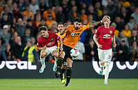Rubén Neves of Wolves fouls Daniel James of Man Utd during the Premier League match between Wolverhampton Wanderers and Manchester United at Molineux, Wolverhampton, England on 19 August 2019. Photo by Andy Rowland.