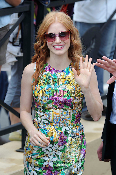 Jessica Chastain.'Madagascar 3' Stars during Cannes Film Festival, Cannes, France, .May 18th 2012..half length green pink floral print dress sunglasses retro hand waving smiling yellow sleeveless shift purple pink tinted .CAP/CAS.©Bob Cass/Capital Pictures.