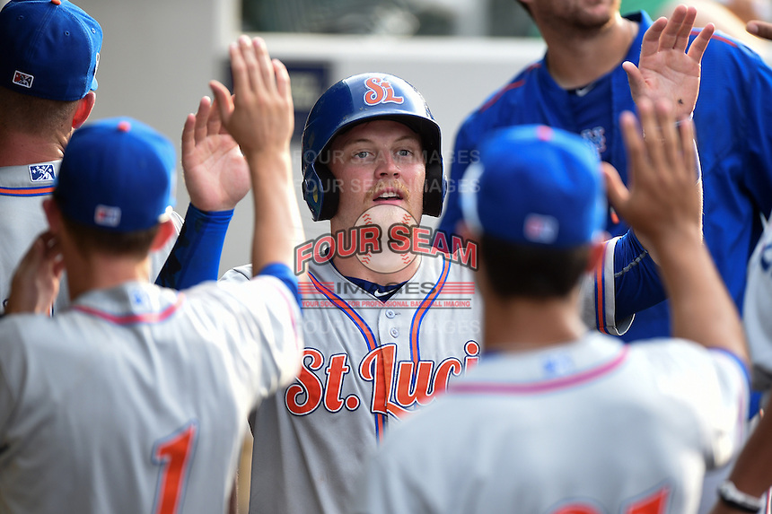 St. Lucie Mets first baseman Matt Oberste (5) high fives teammates after scoring a run during a game against the Fort Myers Miracle on April 19, 2015 at Hammond Stadium in Fort Myers, Florida.  Fort Myers defeated St. Lucie 3-2 in eleven innings.  (Mike Janes/Four Seam Images)