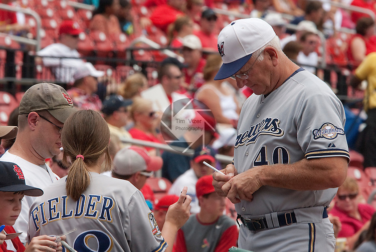 July 4, 2010          Milwaukee Brewers manager Ken Macha (40) signs autographs for fans before the start of the game.  The St. Louis Cardinals defeated the Milwaukee Brewers 7-1 in the final game of a four-game homestand at Busch Stadium in downtown St. Louis, MO on Sunday July 4, 2010.