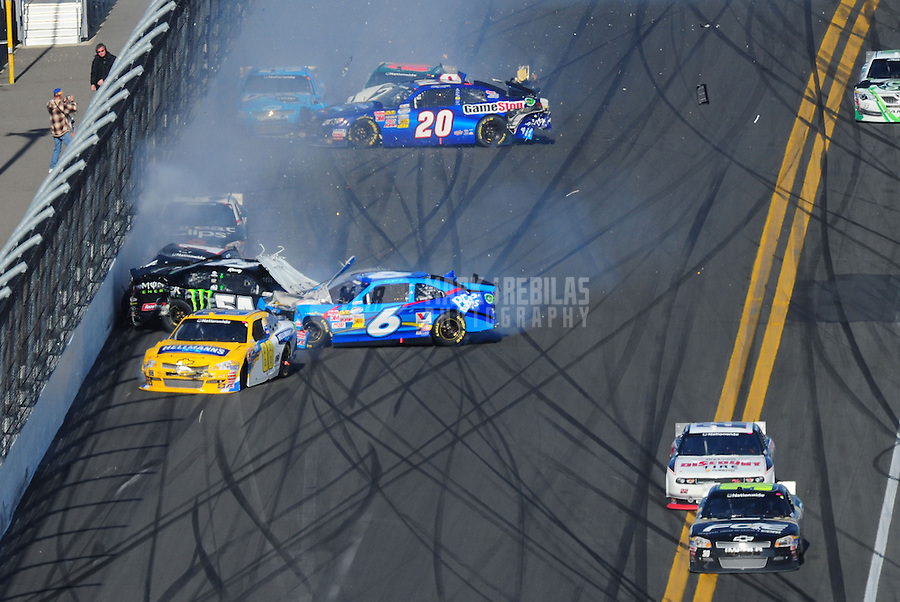 Feb. 25, 2012; Daytona Beach, FL, USA; NASCAR Nationwide Series drivers James Buescher (30) and Brad Keselowski (22) go low as Kyle Busch (54), Ricky Stenhouse Jr (6), Cole Whitt (88), Kurt Busch (1), Kasey Kahne (38), Joey Logano (20), Trevor Bayne (60), Tony Stewart (33) and Elliott Sadler (2) crash on the last lap during the DRIVE4COPD 300 at Daytona International Speedway. Mandatory Credit: Mark J. Rebilas-