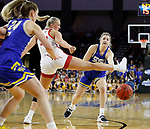 SIOUX FALLS, SD - MARCH 10: Paiton Burckhard #33 of the South Dakota State Jackrabbits passes the ball under the leg of Hannah Sjerven #34 of the South Dakota Coyotes during the women's championship game at the 2020 Summit League Basketball Tournament in Sioux Falls, SD. (Photo by Richard Carlson/Inertia)