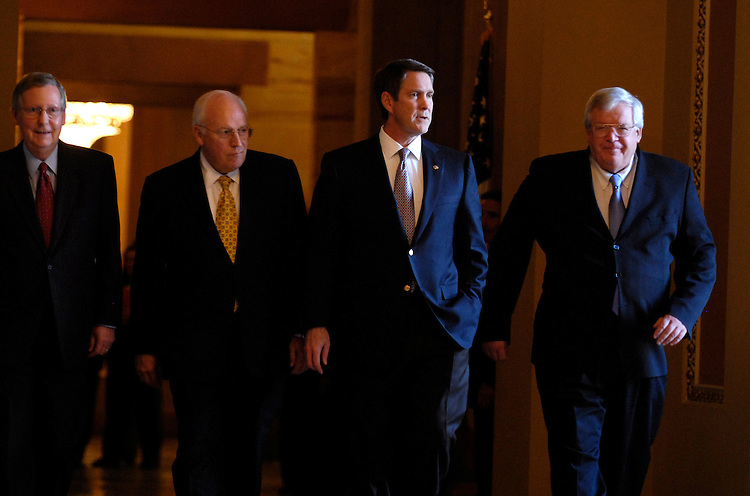 From Left, Sen. Mitch McConnell, R-Ky., Vice President Dick Cheney, outgoing Senate Majority Leader Bill Frist, R-Tenn., and Speaker Dennis Hastert, R-Ill., make their way to the Senate Chamber for Frist's farewell address.