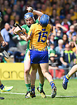 Richie McCarthy of Limerick in action against Shane O'Donnell of Clare during their Munster Championship semi-final at Thurles.  Photograph by John Kelly.