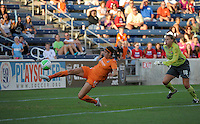 Sky Blue FC defender Brittany Taylor (14) makes an incredible save of a sure goal while goalkeeper Kristin Luckenbill (18) looks on.  The  Chicago Red Stars defeated the Sky Blue FC 2-0 at Toyota Park in Bridgeview, IL on July 10, 2010.