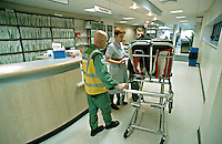 Paramedic ambulance crew booking a patient into an accident and emergency department of a hospital. This image may only be used to portray the subject in a positive manner..©shoutpictures.com..john@shoutpictures.com