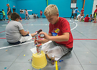 NWA Democrat-Gazette/BEN GOFF @NWABENGOFF<br /> Layton Patterson, 10, of Rogers crafts a trophy out of recyclable materials Friday, July 6, 2018, during the Rogers Activity Center summer day camp.