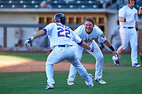 Mesa Solar Sox first baseman Jason Vosler (22), of the Chicago Cubs organization, celebrates with third baseman Sheldon Neuse (20) after hitting a two-RBI walk-off triple against the Surprise Saguaros on October 20, 2017 at Sloan Park in Mesa, Arizona. The Solar Sox walked-off the Saguaros 7-6.  (Zachary Lucy/Four Seam Images)
