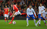 Gareth Bale of Wales is challenged by Luka Milivojevic of Serbia during the FIFA World Cup Qualifying match at the Cardiff City Stadium, Cardiff. Picture date: November 12th, 2016. Pic Robin Parker/Sportimage