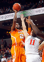 Tennessee forward Kenny Hall (20) shoots over Virginia forward Evan Nolte (11) during the game Wednesday in Charlottesville, VA. Virginia defeated Tennessee 46-38.