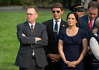 From left to right: Acting White House Chief of Staff and Director of the Office of Management and Budget (OMB) Mick Mulvaney, White House Deputy Press Secretary Hogan Gidley, and White House Press Secretary Stephanie Grisham await the arrival of United States President Donald J. Trump and first lady Melania Trump who will observe a moment of silence at 8:46am EDT in commemoration of  the 18th anniversary of the terrorist attacks on the World Trade Center in New York, NY and the Pentagon in Washington, DC on Wednesday, September 11, 2019.<br /> Credit: Ron Sachs / CNP /MediaPunch