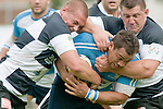 Lance Persico (L) and his team mate John Rawson (R) tackle Carl Manu of Lazio during the rugby match between SS Lazio Rugby and Rugby Roma Olimpic in Rome on September 26, 2010.