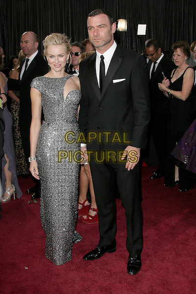 Naomi Watts (wearing Armani Prive) & Liev Schreiber  .85th Annual Academy Awards held at the Dolby Theatre at Hollywood & Highland Center, Hollywood, California, USA..February 24th, 2013.oscars full length  gunmetal grey gray sequins asymmetrical sequined liquid glittering gown with cutout neckline stubble facial hair dress metallic black suit couple .CAP/ADM.©AdMedia/Capital Pictures.