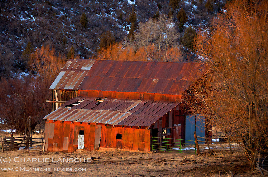 Exposed corrugated metal siding stands the test of time on this aging hay barn in Summit County, Utah. January 2012.