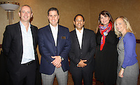 NWA Democrat-Gazette/CARIN SCHOPPMEYER Gregg Parsons (from left), Hank Schepers, Carlos Barragan, Emma Grant and Stacie Furlano of Colgate Palmolive stand for a photo at the corporate luncheon VIP reception on Monday.