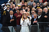 Ex-President Barack Obama listen to the National Anthem sung by 16-year-old Jackie Evancho at the end of the Inauguration Ceremony on January 20, 2017 in Washington, D.C.  Donald Trump became the 45th President of the United States.         <br /> Credit: Pat Benic / Pool via CNP