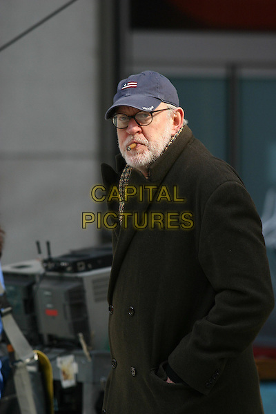 FRANK OZ.filming the title sequence for his new film The Stepford Wives, New York City .7 March 2004..half length, half-length, baseball cap hat, smoking cigar.www.capitalpictures.com.sales@capitalpictures.com.©Capital Pictures.