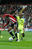 Andre Wisdom of Derby County tackles Romaine Sawyers of Brentford during the Sky Bet Championship match between Brentford and Derby County at Griffin Park, London, England on 26 September 2017. Photo by Carlton Myrie / PRiME Media Images.