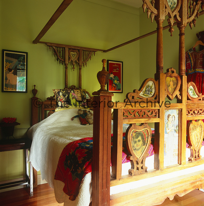 A theatrical Indian bed in one of the guest bedrooms