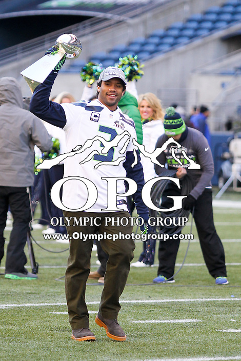 2014-02-05:  Seattle Seahawks quarterback Russell Wilson brought the Lombardi Trophy onto the field during the trophy celebration. Seattle Seahawks players and 12th man fans celebrated bringing the Lombardi trophy home to Seattle during the Super Bowl Parade at Century Link Field in Seattle, WA.